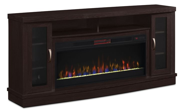 Create a cozy atmosphere in your family room with this Hutchinson 70-inch TV stand with glass ember firebox. With enough space and support for your big screen television and all your home theatre accessories, this TV stands sets family movie night up for success. Warm up in a flash with the built-in fireplace or just enjoy the realistic flame without the heat. Thanks to the fireplace's compatibility with any standard outlet, you can use this TV stand anywhere from your bedroom to your ba...