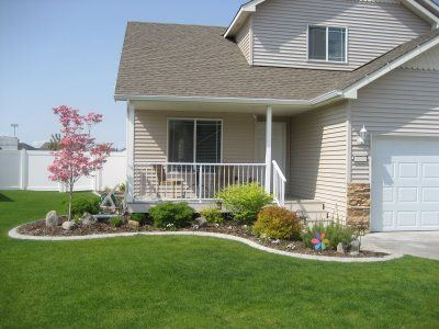 Small porch designs porch railing and small garden for Beautiful small front yards