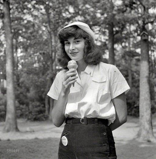 "Gloria - Campfire Scene  Dairy Queen: August 1942. ""Interlochen, Michigan. National music camp where 300 or more young musicians study symphonic music for eight weeks each summer. A student eating an ice cream cone."" Photo by Arthur Siegel"