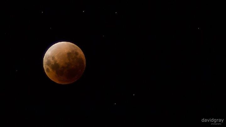 Here's a quick shot from tonight's Super Blue Blood Moon. If you're still awake and can't get outside to see the show NASA is live streaming it over on YouTube and is definitely worth the watch: https://www.youtube.com/watch?v=wwMDvPCGeE0  To get this shot I dug out my 70-300mm zoom lens which jams up whenever the aperture is anything other than wide open. That makes it useless during the day but perfect at night. I also ramped up the ISO so I could get a steadier shot then sharpened it and…