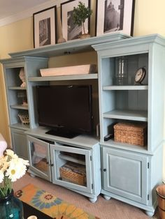 Annie Sloan chalk painted entertainment center | The Style Sisters & like the photos on top of the cabinet