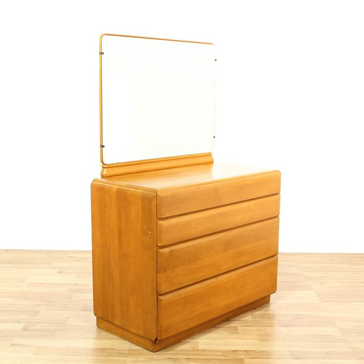 This mid century modern dresser is featured in a solid wood with a glossy light maple finish. This short dresser has 4 drawers, curved edges and a large mirror top. Simple retro storage piece perfect for a minimalist space! #americantraditional #dressers #longdresser #sandiegovintage #vintagefurniture