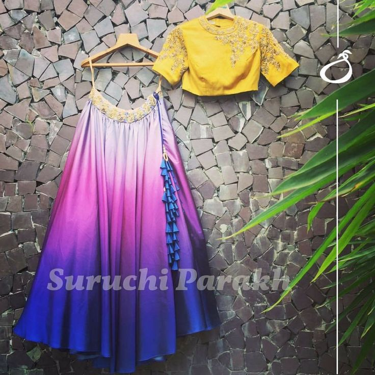 A beautiful amalgamation of colors. Beautiful lehenga and yellow color designer crop top with hand embroidery gold thread work.  17 August 2017