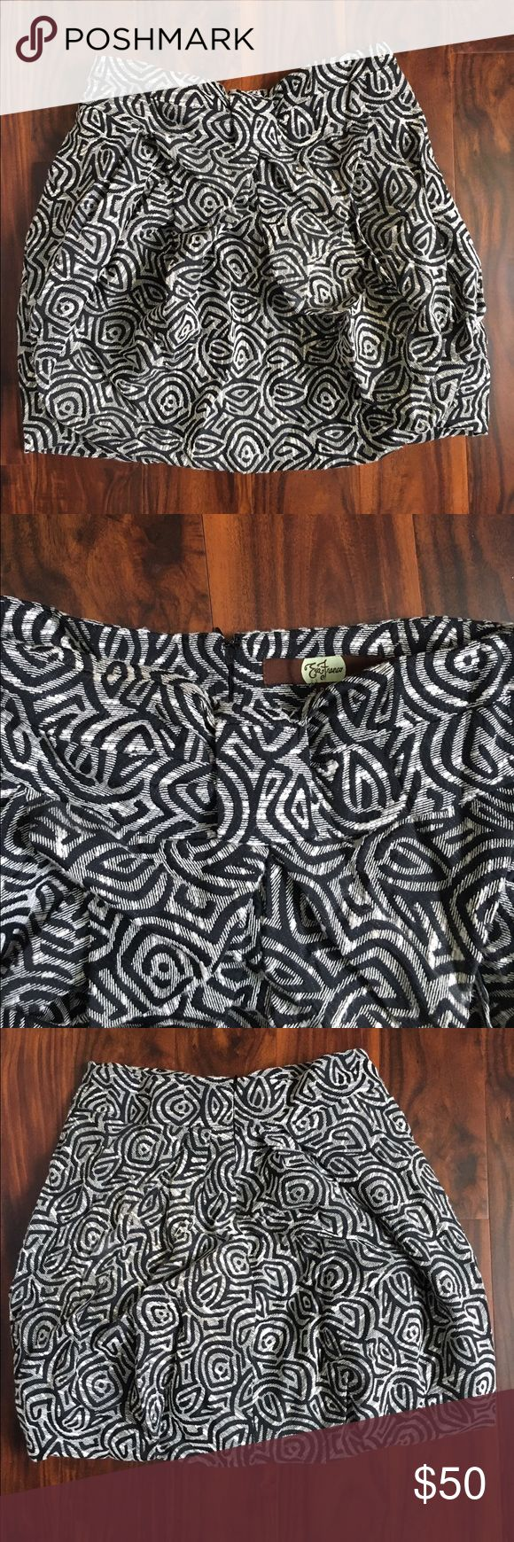 Anthropologie Eva Franco Draped Jungle Skirt Cute skirt with cinched waist and bubble hem. Black and white geometric print and bow at waist. Back zipper. Anthropologie Skirts