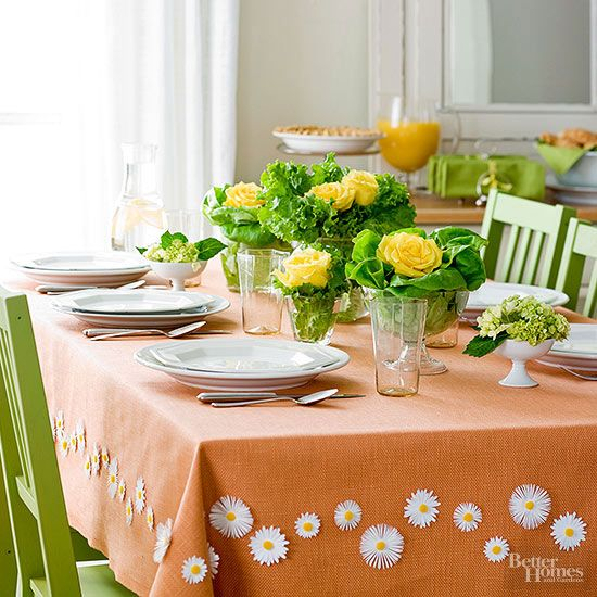 Set a pretty brunch table on Mother's Day without a lot of fuss. Just use this budget-friendly spin on floral arrangements. Simply nestle a few roses in beds of leaf lettuce and create a showstopping effect from only a couple of elements./
