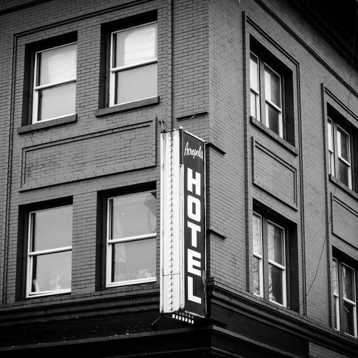 The Acropolis Hotel in downtown Portland, Oregon on Burnside Street.    Some of the most historic type of architecture is still found in Portland and a picture captures the view and creates a great topic of discussion!
