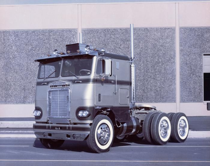 White Freightliner with 5 hole Alcoa wheels and white walls. Classic