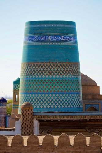 Kalta Minor Minaret, Uzbekistan. Just south of the Kuhna Ark stands the fat, turquoise-tiled Kalta Minor Minaret. This unfinished minaret was begun in 1851 by Mohammed Amin Khan, who according to legend wanted to build a minaret so high he could see all the way to Bukhara. Had it been completed it surely would have been the world's tallest building, but the Khan dropped dead in 1855 and it was never completed.