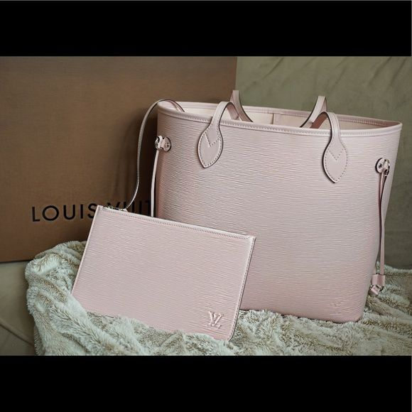 Exclusive authentication service & customer support. Free 1-3 day shipping for a limited time. Description: Hi ! I'm selling my next to brand NEW Louis Vuitton Epi Leather Tote in a soft Ballerina Pink :) Its is on the website still , retailing for $2050.00 and I am selling this item for $1500 because it sat with me for 1 year. I only used it ONCE. No scratches or worn anything on it and it comes with the small bag :). Sold by taniamaria_mua. Fast delivery, full service customer suppo...