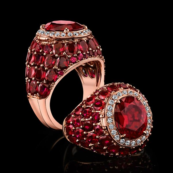 Robert Procop Exceptional Jewels.This stunning rubellite center stone is accented with surrounding rubies totaling over seven carats. Framed by a row of white diamonds, the top gem surprisingly opens up to reveal a secret compartment. All gems on this impressive piece is expertly set in hand sculpted 18k rose gold.