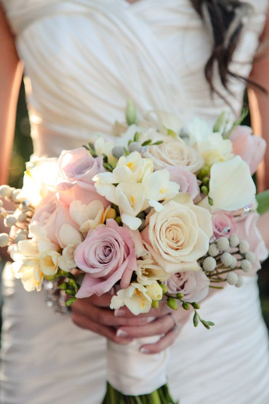Another great bouquet...this one is pastel for 2012... Soft gray-purple cool water roses, white freesia with great tails, and gorgeous gray berries.