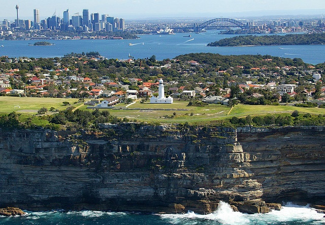 Sydney from Vaucluse view. Macquarie Lighthouse in the foreground, NSW, Australia