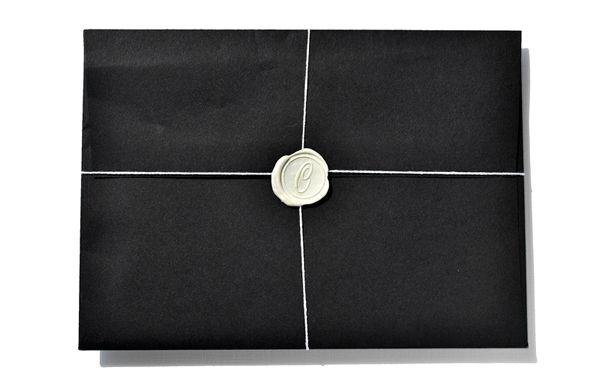 White wax, black envelope.