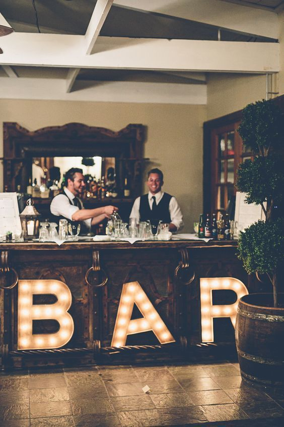 If there's one aspect of your wedding that all your guests will want lit up in lights, it's the bar! This one has a vintage, speakeasy vibe to it that totally sets the mood for the party portion of the evening.