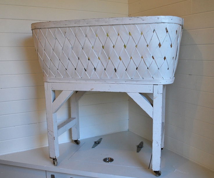 antique white wooden wicker bassinet, vintage cradle, sweet shabby chic or farmhouse style.