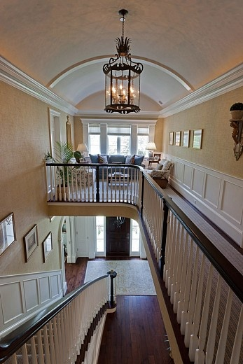 I love the idea of a room over the entryway. You could put a Christmas tree there. :)