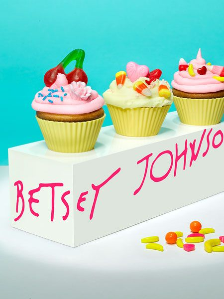 The Betsey Johnson cupcake, makes use of bright popping colors and includes key Betsey Johnson icons such as the cherry and heart