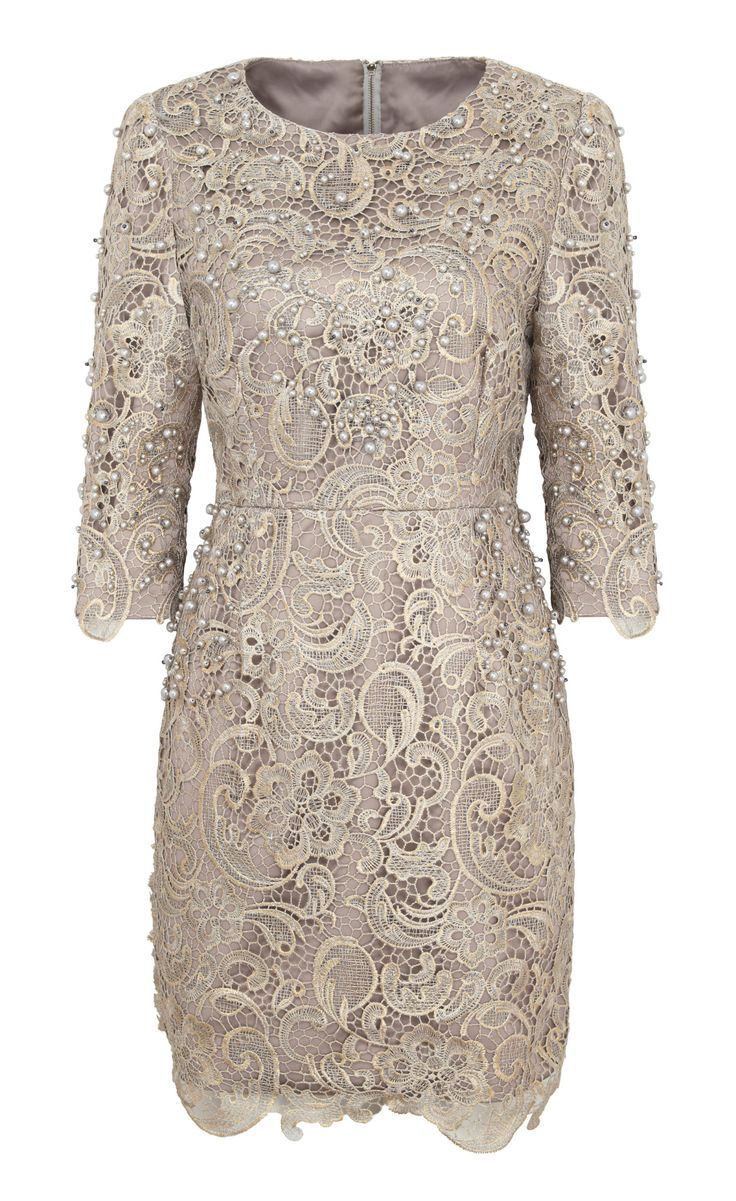 Don't shy away from mini dresses for weddings, just keep the neckline high and the sleeves long. -Cosmopolitan.co.uk