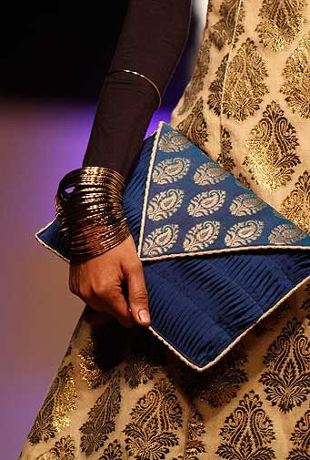 Love accessories and clothes that have a little Indian touch. This brocade envelope clutch is beautiful!