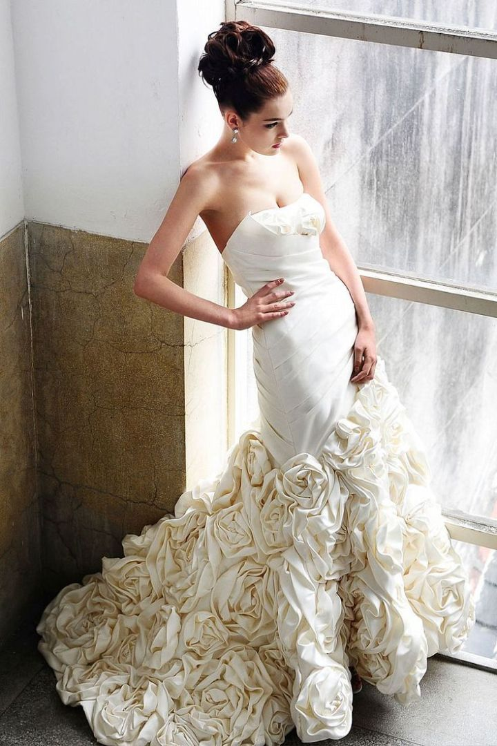 The floral detailing on this wedding dress is to die for! | Saison Blanche Wedding Dresses