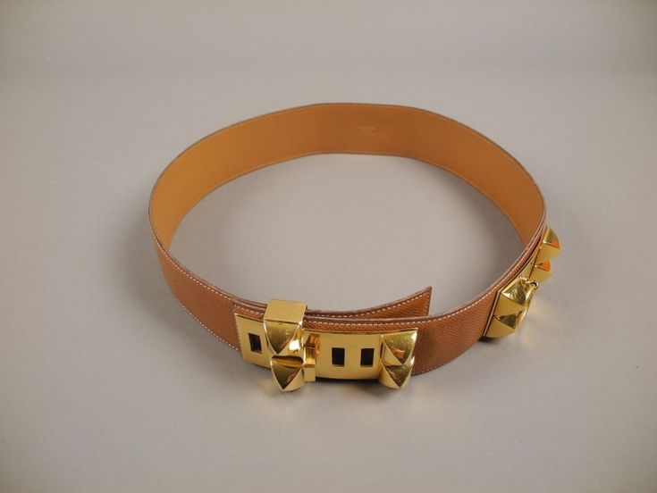 """HERMES Ceinture """"Collier de chien"""" en cuir brun, garnitures en métal doré L: 89 cm - Aguttes - 09/12/2014"""