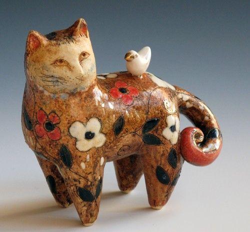 cat and bird by margaret wozniak