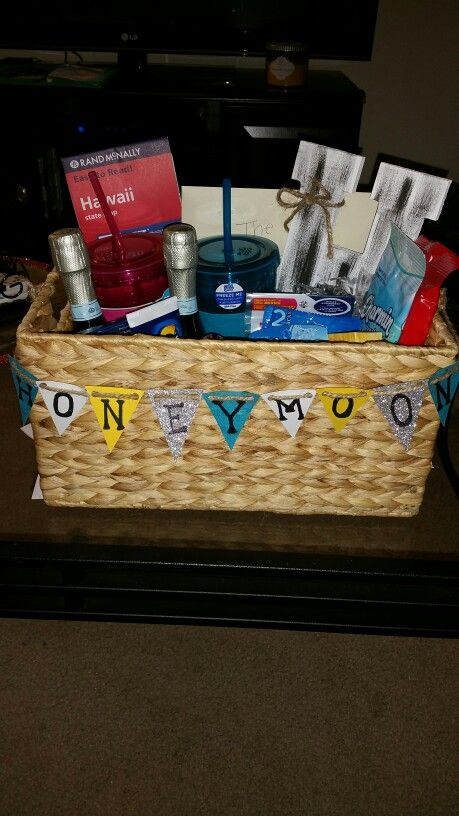 Honeymoon Survival Kit.  Full of goodies for the couple to enjoy while on their honeymoon like travel cups, wipes, massage oil, sunscreen, etc.  Plus a basket that can be reused in the home.