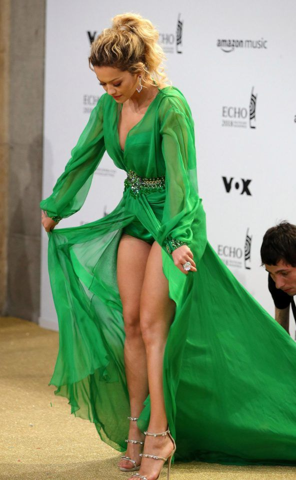 92372aec3909a Rita Ora shows off her legs in plunging green dress at the Echo ...