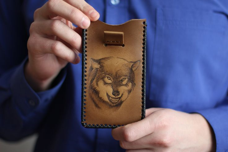 "iPhone case ""The Wolf"". The material of product is the natural leather. There is burned image of the wolf on the front part. We will can make specially case for your cellphone with your image. 18.69$ (isn't including shipping) #leathercase #tablet #iphone #handmade #russianhandmade #russian #russian_handmade #naturalleather #leather #cover #wolf #case"