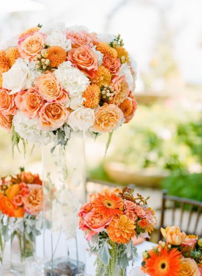 Peach and orange wedding flowers: http://www.stylemepretty.com/2014/11/08/bright-orange-malibu-wedding/ | Photography: Erin Hearts Court - http://www.erinheartscourt.com/