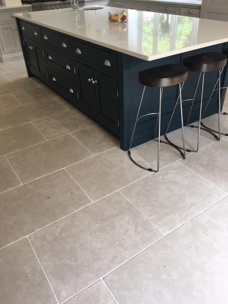 Grey kitchen floor tiles - Paris Grey limestone antiqued tumbled. Large format natural stone flooring with consistent tone.  http://www.naturalstoneconsulting.co.uk/limestone-paris-grey-limestone