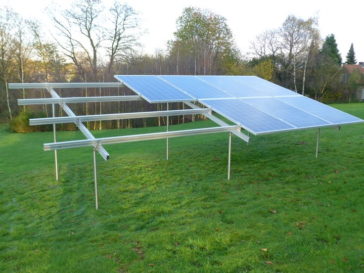 6 Eco Friendly Diy Homes Built For 20k Or Less: Halfway The Installation Of 12 Solar Panels In Open Field