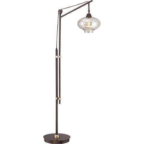 "Calyx Cognac Glass Industrial Bronze Floor Lamp 66"" high x 24"" wide. Round base is 12"" wide. Glass shade is 10 1/2"" wide x 8"" high. $245"