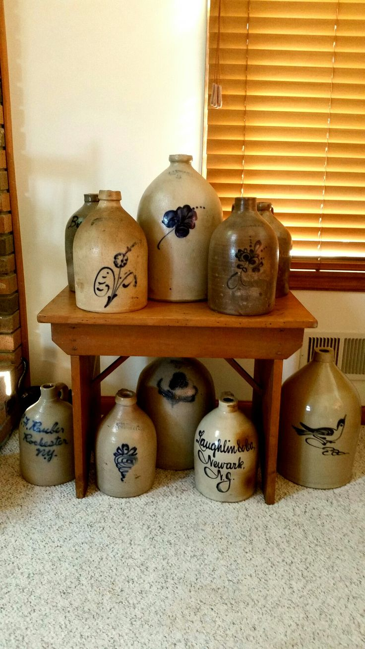 Antique stoneware jugs. I would sooooo love to have this display.