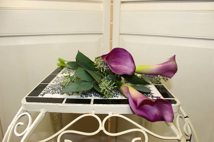 Gorgeous Calla Lily Bridesmaid Bouquet! Stop in or call now, the information is located in our bio.
