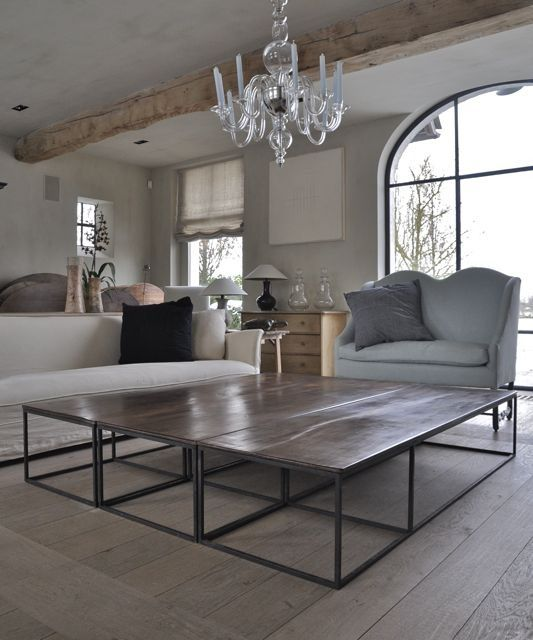 several coffee tables combined to make one very large coffee table could  put could wicket baskets with blankets etc.