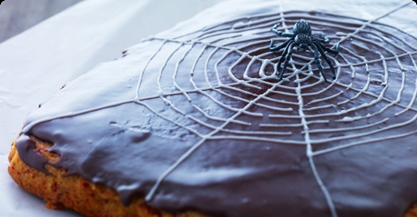 Scary Halloween cake with a spider web