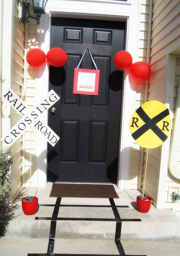 Train themed 2nd Birthday Party- www.ladyslittleloves.com - Easy duct-tape tracks on the side walk and DIY signs