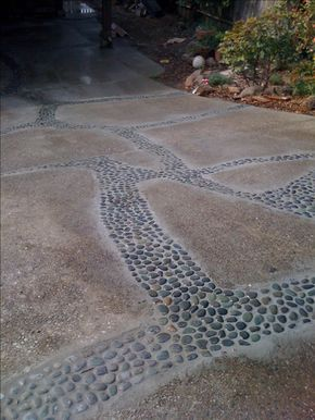 A creative, low cost way to deal with a cracking driveway. First you widen the cracks a little, then add reinforcincing rebar and concrete, top with rocks and morter in the stones. Great inexpensive solution to and expensive replacement!
