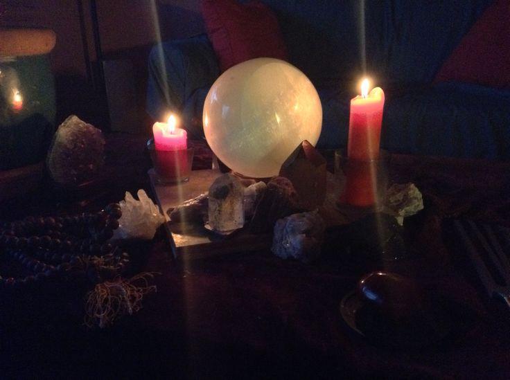 Selenite sphere centered crystal grid.