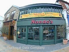 Nando's in London. Wimbledon location. My cousins always take us there. Spicy food, famous for marinated and grilled chicken dishes. Fun pub.