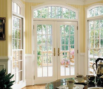 French doors lead to a patio from the kitchen