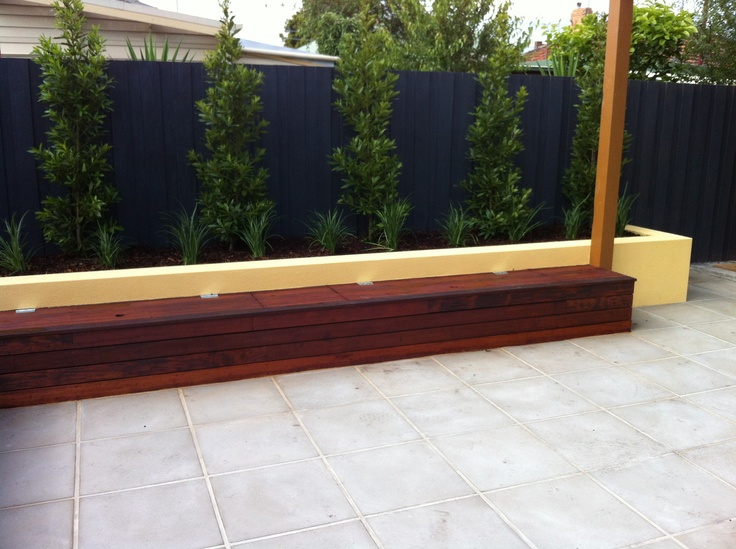Merbau seat and riverstone paving