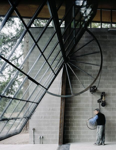 Wall Window of Chicken Point Cabin. Olson Kundig Architects. LOVE the enormity of the cabin's big window-wall (30 feet by 20 feet)! It opens the entire living space to the forest and lake. Plus, I love the look of the wheel instead of hidden electronics.