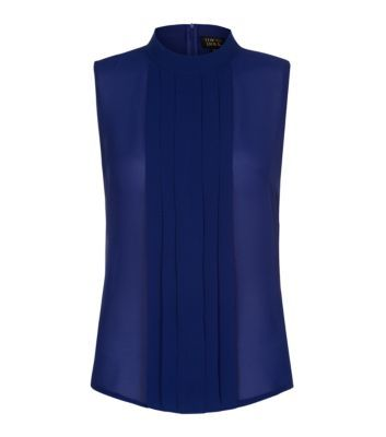 Cobalt blue is a great way to brighten up your winter wardrobe, and this blouse also combines the high neck trend.