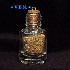 Fiole en verre garni de microbille fine couleur or 38mmx21mm