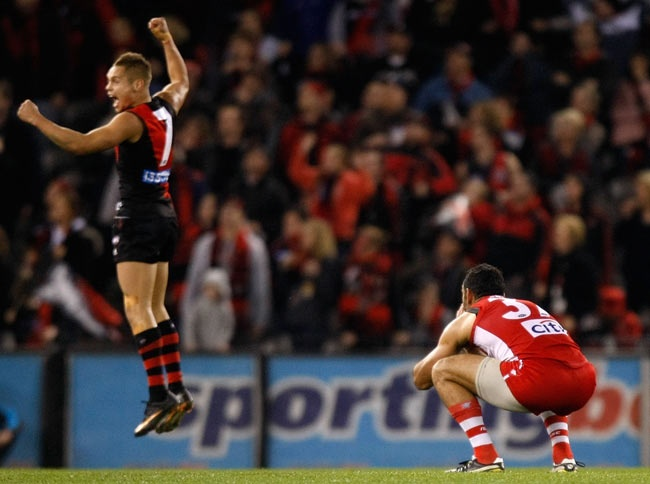 Adam Goodes misses a shot after the siren, leading Leroy Jetta to celebrate an Essendon victory over Sydney in 2011.