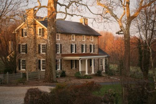 Classic stone Pennsylvania house with black shutters
