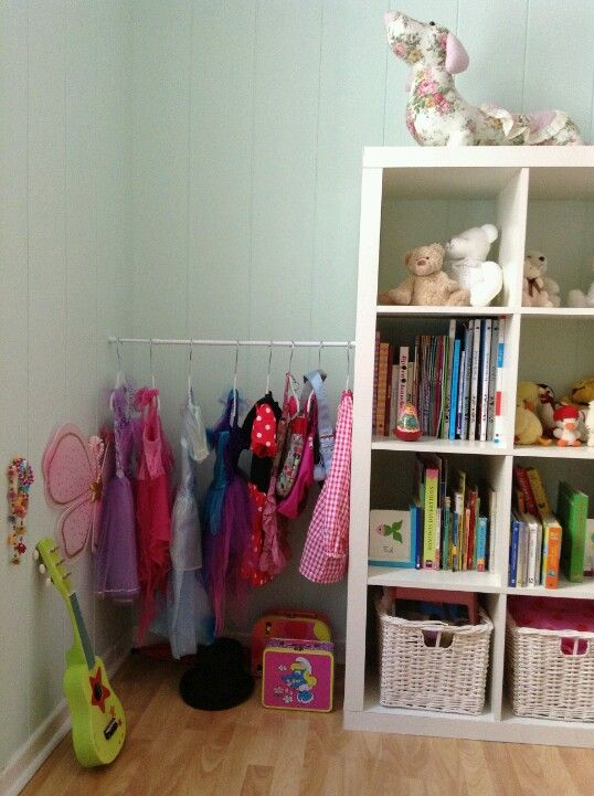 Dafne's room dress up corner with tension rod between furniture and wall