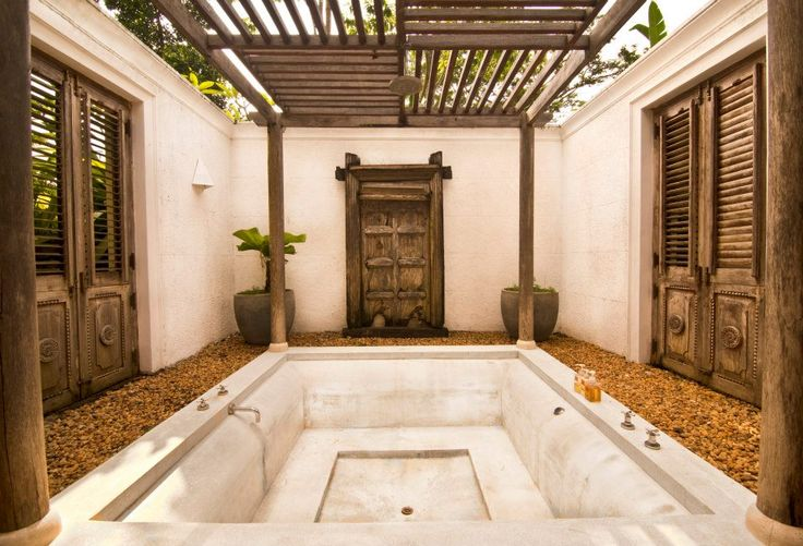 Dubu suite  at Kahanda Kanda  - Unique Antique Joglo House from Java with elaborately carved wooden ceiling, Mixture of antique and contemporary furniture, Elegant King Size Teak Sleigh Bed, Woven Palm walls with numerous louvred doors for a truly open feeling, Large wrap-around verandah overlooking the garden, Private Swimming Pool for your exclusive use & Luxurious Cotton Bed linen